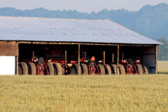 Parked Tractors and Wheat Field Royalty Free Stock Photo