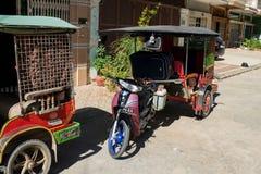 Parked tuk-tuks in Phnom Penh Cambodia royalty free stock image