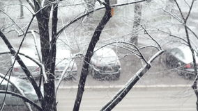 Parked vehicles on the street during the snowfall stock footage