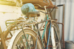 Parked vintage bicycles bikes for rent on sidewalk. Stock Photo