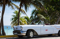 Parked white classic car near the beach in Cuba Havana Stock Image