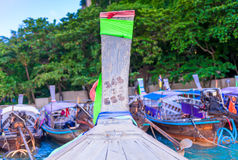 Parked wooden Thai boats long tail. Off shore stock photography