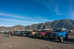 Parked 4x4 Jeeps on a desert Royalty Free Stock Image