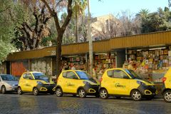 Parked yellow Share`ngo cars. Rome, Italy - August 16, 2017: Share`ngo cars. SHARE`NGO is an Italian platform for the development of electric and sustainable Royalty Free Stock Image