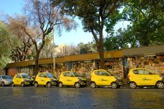 Parked yellow Share`ngo cars. Rome, Italy - August 16, 2017: Share`ngo cars. SHARE`NGO is an Italian platform for the development of electric and sustainable Royalty Free Stock Photo