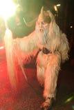 Parkelj European traditional mask. PODKOREN, SLOVENIJA - NOVEMBER 27th 2015: Unidentified man wears Krampus (devil) mask at traditional procession 'Parkelj Stock Images