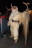 Parkelj European traditional mask. PODKOREN, SLOVENIJA - NOVEMBER 27th 2015: Unidentified man wears Krampus (devil) mask at traditional procession 'Parkelj Royalty Free Stock Photos
