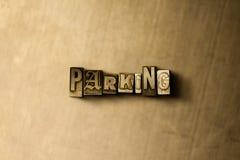 PARKEN - Nahaufnahme der grungy Weinlese setzte Wort auf Metallhintergrund Lizenzfreies Stockbild