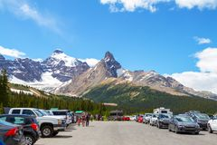 Parker Ridge Hiking Trailhead in Jasper National Park Canada. JASPER, CANADA - JUL 8, 2018: Visitors stop at the Parker Ridge hiking trailhead parking lot on the royalty free stock photography