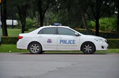 Parkerad Singapore polisbensindriven bil Royaltyfri Bild