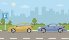 Parkeringsplats med två bilar på stadsbakgrund Arkivfoto