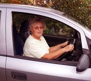 Parking. Lady driver parking her automobile senior citizen Royalty Free Stock Images