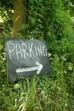 Parking. Chalk parking sign in the middle of the grass Royalty Free Stock Photography