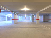 Parking. Un underground parking garage empty of cars stock images
