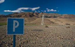 Parking. Sign post for parking in the desert stock photography