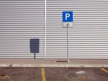 Parking. Empty parking place provided for invalid person vehicle Stock Photos