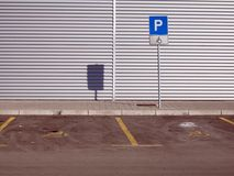Parking. Empty parking place for invalid person vehicle Royalty Free Stock Photography