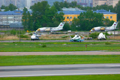 The parking of aircrafts and helicopters in Pulkovo International airport in Saint-Petersburg, Russia Royalty Free Stock Photos