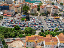 Parking area full of cars beneath the mountain in gibraltar Stock Photography
