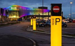 Parking area and illuminated front of the retail park Shopping City South Stock Image