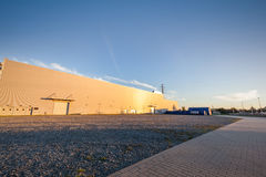 Parking area outside big warehouse. Urban, industrial Stock Image