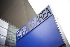 Parking area signage on blue background Stock Photos