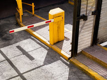 Parking Barrier. Entrance of a parking garage with the barrier closed and vivid yellow Stock Image