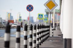 Parking Barrier on Paved Sidewalk Royalty Free Stock Photo
