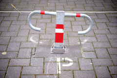 Parking barriers. A parking barrier or parking bracket on a private parking lot Royalty Free Stock Photos