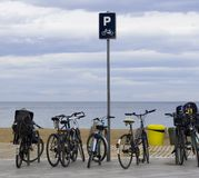 Parking in the beach. Bicycle parking in front of the beach. Enjoy the beach Stock Image