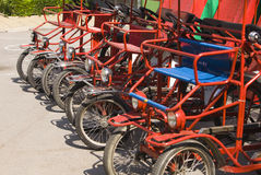 Parking  beach automobile-bicycles Stock Photography