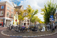 Parking of bicycles on the bank of the channel in Delft Royalty Free Stock Photo