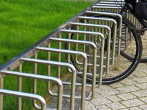Parking for bicycles in the park royalty free stock image