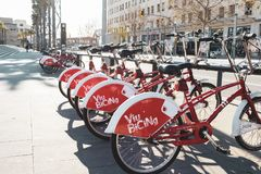 Parking of bicycles for rent in Barcelona stock images