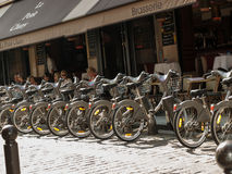 Parking of bicycles for rent on the streets of Paris Stock Image