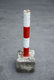 Parking blockage device in red and white Royalty Free Stock Photo