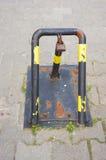 Parking blocker. Close-up of an metal parking blocker royalty free stock photos