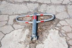 Parking blocker. Unactivated parking blocker on hard asphalt stock images