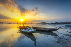 Parking boat in the beach village beach. Location sekupang sub-districts, batam city, indonesia country, moment sunset, high tide, background yellow sun stock image