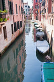 Parking of boats on canal in Venice, Italy Stock Images