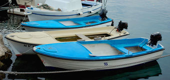 Parking Boats in Harbour. Parking Blue Boats in Harbour Stock Image