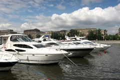 Parking boats on the Moscow river. Yacht standing on the pier on the Moscow river Royalty Free Stock Image