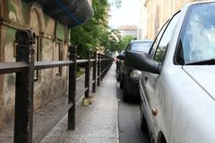 Parking cars in the city Royalty Free Stock Photo
