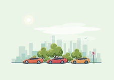 Parking Cars and City Background with Green Trees Royalty Free Stock Image