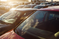 Parking cars on a parking space in backlit Stock Image