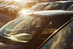 Parking cars on a parking space in backlit Stock Photo