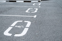 Parking for cars, places for the disabled, sign on the asphalt. Stock Images