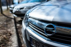 Parking cars in row, focus on the Opel logo. royalty free stock photo