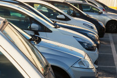 Parking cars in a row Royalty Free Stock Images