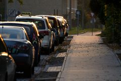 Parking cars with a taxi along pavement Royalty Free Stock Photography